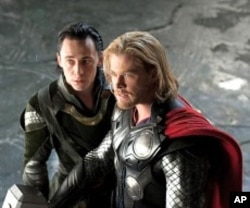 Left to right: Loki (Tom Hiddleston) and Thor (Chris Hemsworth) in THOR, from Paramount Pictures and Marvel Entertainment.