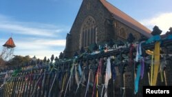 Colorful ribbons can be seen tied to the fence outside St. Patrick's Cathedral, a spontaneous gesture to remember victims of Roman Catholic church abuse, in the town of Ballarat, located west of the southern city of Melbourne in Australia, July 23, 2017.