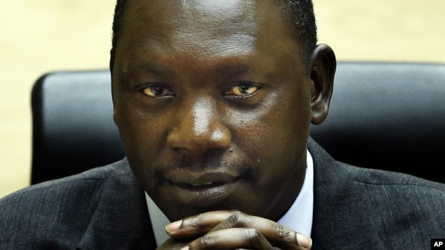 Congolese warlord Thomas Lubanga awaits his sentence in the courtroom of the International Criminal Court in The Hague, July 10, 2012.