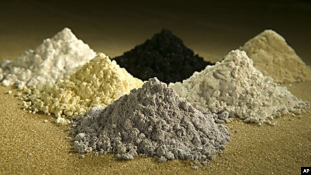 Rare earth oxides from top center clockwise: praseodymium, cerium, lanthanum, neodymium, samarium, and gadoliniun, October 7, 2010.