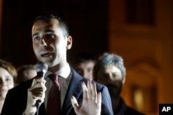 5-Star Movement lawmaker Luigi Di Maio talks during a movement's protest outside the Italian Parliament moments after a new election law was approved by the Lower Chamber of Deputies, in Rome, Thursday, Oct. 12, 2017.