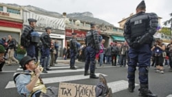 An anti-G20 demonstrator at the France-Monaco border on Thursday