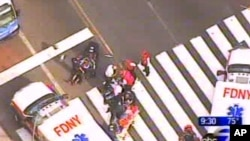 In photo from WABC-TV, emergency personnel respond to reports of several people being shot outside the Empire State Building, Aug. 24, 2012, in New York. Authorities say the shooter is dead.
