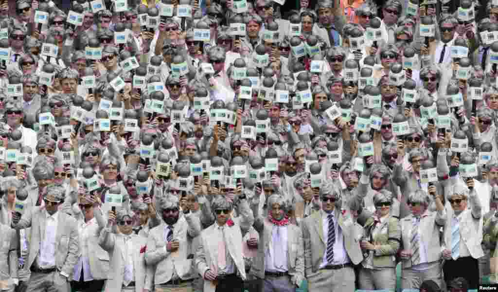 Fans dressed as the late cricket player and commentator Richie Benaud, paying tribute to him while watching the third cricket test between Australia and the West Indies at the SCG in Sydney.