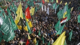 Palestinians celebrate the Israel-Hamas cease-fire in Gaza City, November 22, 2012.