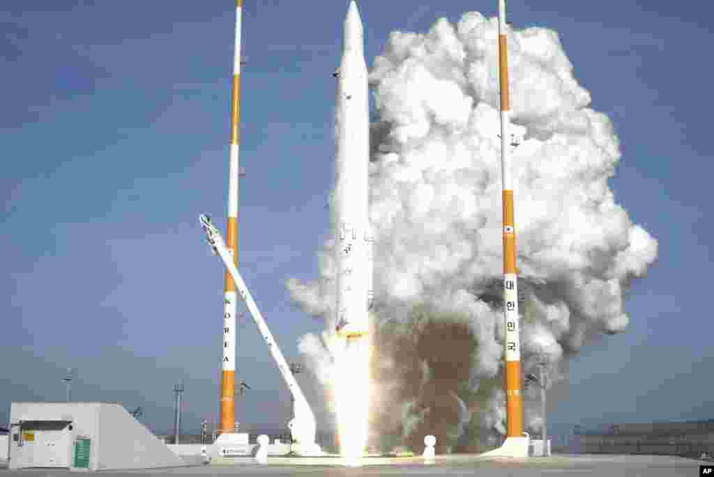 In this photo released by the Korea Aerospace Research Institute, South Korea's rocket lifts off from its launch pad at the Naro Space Center in Goheung.  South Korea says it has successfully launched a satellite into orbit from its own soil for the first time.