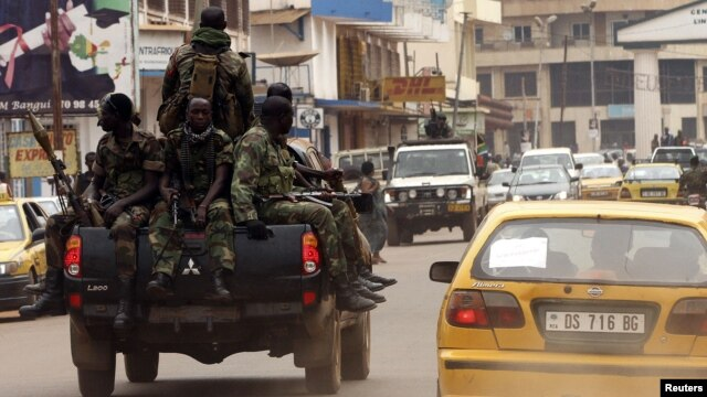 Central African soldiers patrol a street in Bangui, Central African Republic, January 7, 2013.
