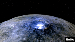 FILE - This representation of Ceres' Occator Crater in false colors shows differences in the surface composition.