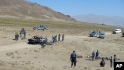 FILE - The scene of an attack is seen in Afghanistan's Paktia province, June 24, 2008.