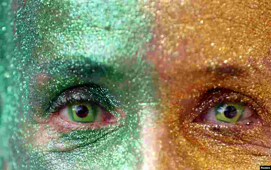 A demonstrator with the design of the national flag in her eyes attends a protest against Brazil's President Dilma Rousseff, part of nationwide protests calling for her impeachment, at Paulista Avenue in Sao Paulo's financial center, Aug. 16, 2015.