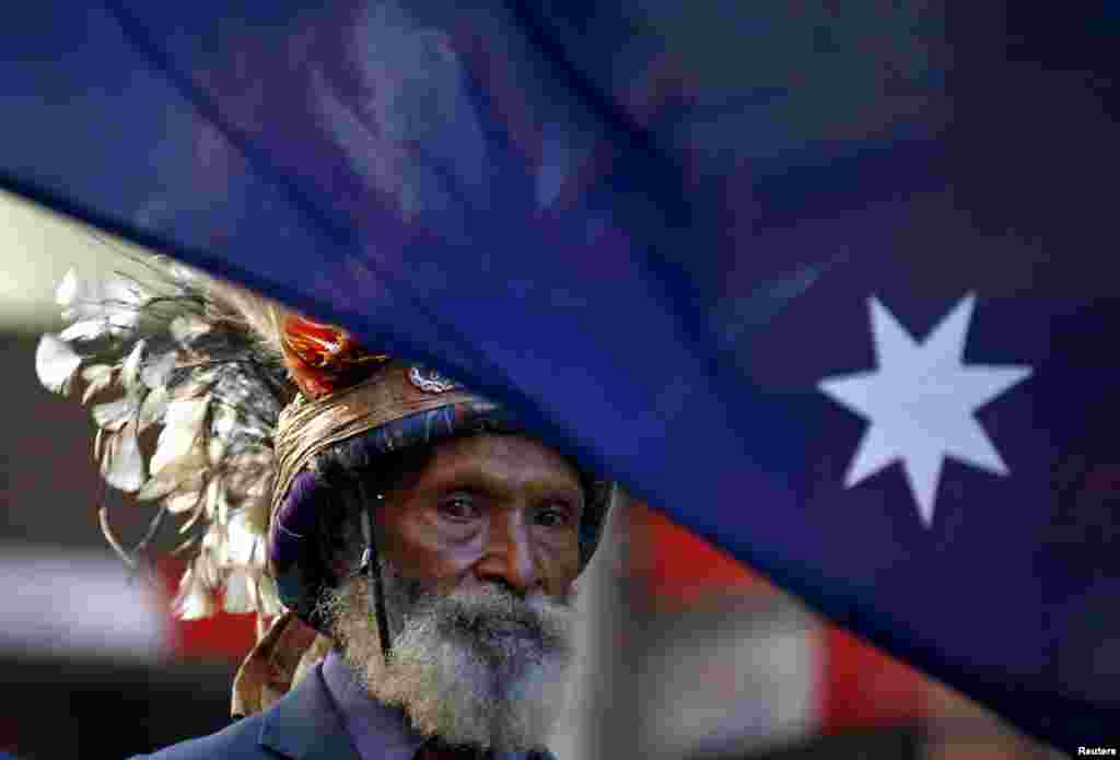 A veteran from Papua New Guinea wears a traditional head dress as he marches during the ANZAC (Australian and New Zealand Army Corp) Day march through central Sydney, Australia.