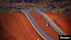 Less of this? China is investing less in Australia's mining industry and more in real estate. The picture shows a conveyor belt at an Australian iron ore mine.
