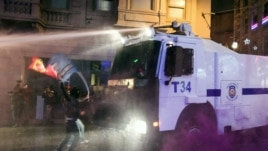 Turkish riot police fire water cannons and tear gas at hundreds of demonstrators who are trying to march to the city's main Taksim Square in Istanbul, Turkey, Saturday, Feb. 8, 2014.