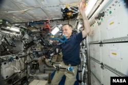 NASA astronaut Ricky Arnold does some filming on the International Space Station Oct. 3, 2018