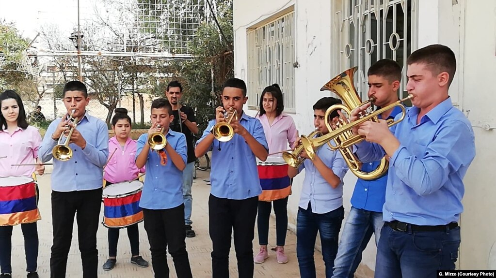 Students practice on instruments donated in Qamishli, Syria, July 2018.