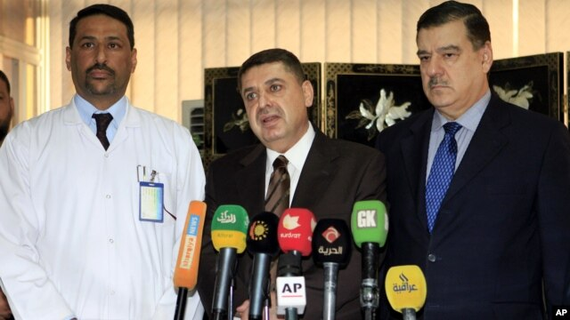 Dr. Essam Namiq, center, deputy Health Minister speaks as Dr. Hani Moussa, left, head of the Iraqi medical team supervising treatment of Iraqi president Jalal Talabani, and Iraq Presidential spokesman listen, Dec. 19, 2012.