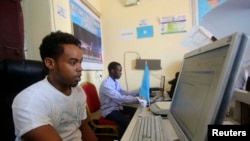FILE - An internet cafe manager uses a computer in the Hodan area of Mogadishu October 9, 2013.