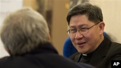 Archbishop of Manila, Philippines, Luis Antonio Tagle, right, at Vatican-backed symposium on clerical sex abuse, Rome, Feb. 9, 2012.