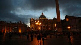 People walk in Saint Peter's Square at the Vatican, March 7, 2013.