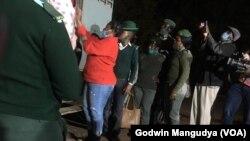 FILE: Joanna Mamombe boarding a prison truck in Harare ...