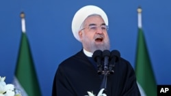 Iran's President Hassan Rouhani speaks at a military parade marking National Army Day in front of the mausoleum of the late revolutionary founder Ayatollah Khomeini, just outside Tehran, April 17, 2016.