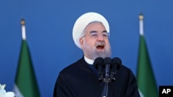 FILE - Iran's President Hassan Rouhani speaks at a military parade.