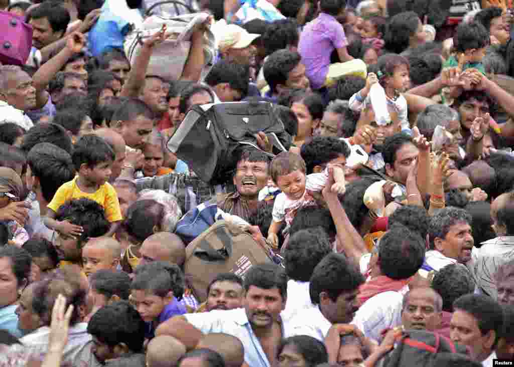 Devotees crowd together at the Maha Pushkaralu, a Hindu festival, on the banks of river Godavari at Rajahmundry in Andhra Pradesh, India. Twenty-seven people were killed and 40 injured in a stampede, police said.