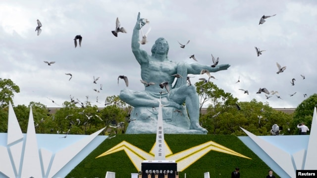 Doves surround the Peace Statue in Nagasaki's Peace Park in a ceremony commemorating the Japanese city's 1945 atomic bombing in photo taken by Kyodo Aug. 9, 2014.