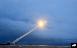 This video grab provided by RU-RTR Russian television via AP television, March 1, 2018, shows the launch of what President Vladimir Putin said is Russia's new nuclear-powered intercontinental cruise missile.
