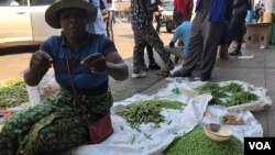 On Sept. 16, 2018, a vegetable vendor in Harare says she refuses to leave her business as she has no other sources of income with Zimbabwe's unemployment rate said to be around 85 percent. (C. Mavhunga/VOA)