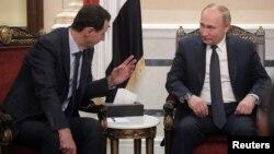 روسی صدر پوٹن دمشق میں شام کے صدر بشار الاسد کے ساتھ