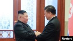 金正恩2019年1月10日在北京會見習近平。