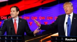 Republican US presidential candidates Marco Rubio (L) and Donald Trump speak simultaneously at the debate sponsored by CNN for the 2016 Republican U.S. presidential candidates in Houston, Texas, Feb. 25, 2016.