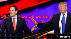 FILE - Republican U.S. presidential candidates Marco Rubio (L) and Donald Trump speak simultaneously at the debate sponsored by CNN for the 2016 Republican U.S. presidential candidates in Houston, Texas, Feb. 25, 2016.