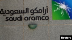 FILE - The logo of Saudi Aramco is seen at Aramco headquarters in Dhahran, Saudi Arabia, May 23, 2018