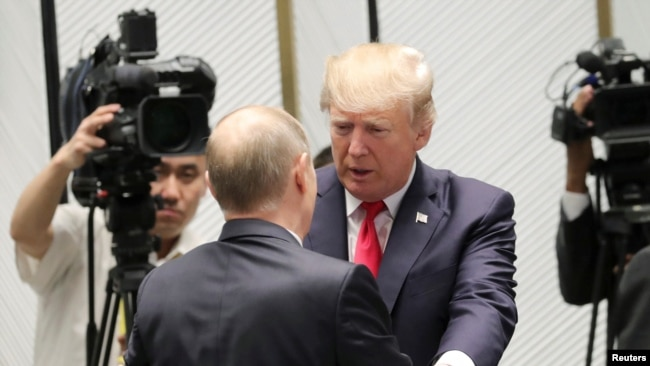 "U.S. President Donald Trump and Russian President Vladimir Putin talk before a session of the APEC summit in Danang, Vietnam, Nov. 11, 2017. ""We seem to have a very good feeling for each other,"" Trump said about his relationship with Putin."