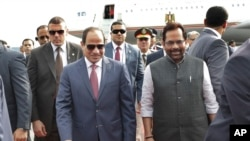 Egyptian President Abdel-Fattah el-Sissi, center left is received by Indian Junior Minister for Minority Affairs and Parliamentary Affairs Mukhtar Abbas Naqvi, right upon arrival at the airport in New Delhi, India, Thursday, Sept.1, 2016.