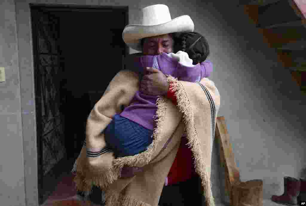 Free Peru party presidential candidate Pedro Castillo hugs his daughter Alondra who cries before he leave home, as he prepares to campaign in Chugur.