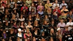 High school students rehearse with professional choristers to prepare for a performance at New York's Carnegie Hall.