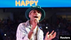 "Pharrell Williams performs his hit song ""Happy"" at the Walmart annual shareholders meeting in Fayetteville, Arkansas, June 6, 2014."