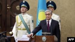 Kazakhstan's Senate chairman Kassym-Jomart Tokayev takes the oath as Kazakh interim president during a ceremony in Astana, March 20, 2019.