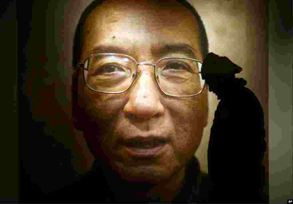 At the Nobel Peace Center in Oslo, a poster showed the face of Liu Xiaobo, a Chinese dissident and winner of this year's Nobel Peace Prize. The prize ceremony will be held Friday, with an empty chair representing Mr. Liu, now serving an 11-year prison sen