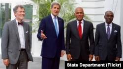 U.S. Secretary of State John Kerry poses for a photo with U.S. Ambassador to Haiti Peter Mulrean, Haitian President Michel Martelly, and Haitian Prime Minister Evans Paul before their meeting at the Presidential Palace in Port-au-Prince, Haiti, on Oct. 6, 2015.
