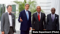 U.S. Secretary of State John Kerry with U.S. Ambassador to Haiti Peter Mulrean, Haitian President Michel Martelly, and Haitian Prime Minister Evans Paul. (Oct. 6, 2015.)