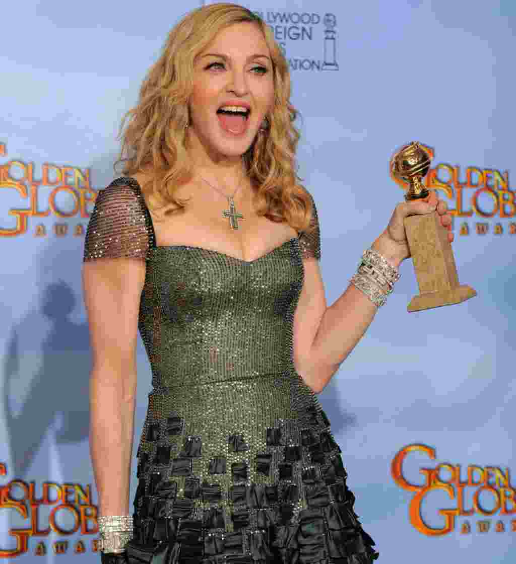 "Madonna poses backstage with the award for Best Original Song in a Motion Picture for the song ""Masterpiece"" from the film ""W.E."" during the 69th Annual Golden Globe Awards on January 15, 2012, in Los Angeles. (AP)"