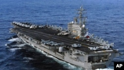 FILE - USS Ronald Reagan was sent to Japan following a 8.9 earthquake and tsunami to render humanitarian assistance and disaster relief as directed, March 12, 2011.