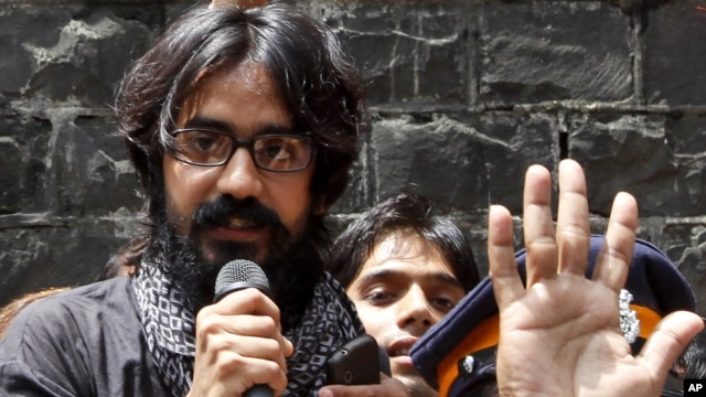 Indian political cartoonist Aseem Trivedi speaks after he was released from jail on bail in Mumbai, India, September 12, 2012.