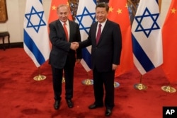 Israeli Prime Minister Benjamin Netanyahu, left, and Chinese President Xi Jinping pose for photographers ahead of their talks at Diaoyutai State Guesthouse, March 21, 2017 in Beijing.