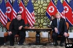 FILE - U.S. President Donald Trump and North Korea's leader Kim Jong Un meet during the second U.S.-North Korea summit at the Sofitel Legend Metropole hotel in Hanoi, Feb. 28, 2019.
