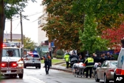 "First responders surround the Tree of Life Synagogue where a shooter opened fire Saturday, Oct. 27, 2018, wounding three police officers and causing ""multiple casualties"" according to Police."